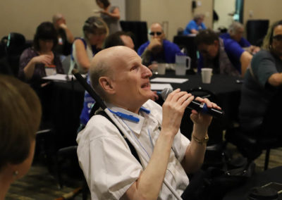 Participant from Iowa asks a question into the microphone as he is attends Ollie Cantos's session at the 2019 SOAR Conference.