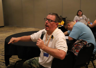 Participant from Kansas asks a question into the microphone as he is attends Ollie Cantos's session at the 2019 SOAR Conference.