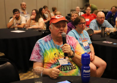 Participant from Missouri asks a question into the microphone as he is attends Ollie Cantos's session at the 2019 SOAR Conference.