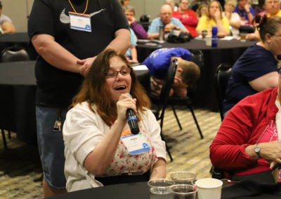 Participant from Missouri asks a question into the microphone as she is attends Ollie Cantos's session at the 2019 SOAR Conference.