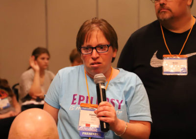 Participant from Nebraska asks a question into the microphone as she is attends Ollie Cantos's session at the 2019 SOAR Conference.